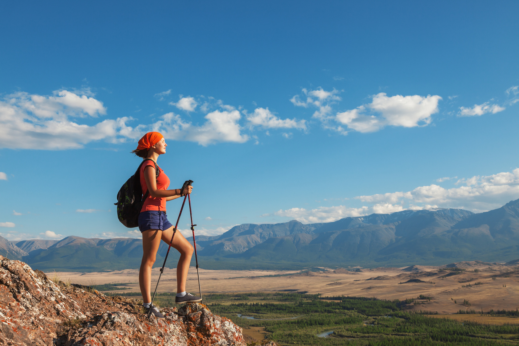 Hiking.Young woman hiker looking at the adventure ahead.