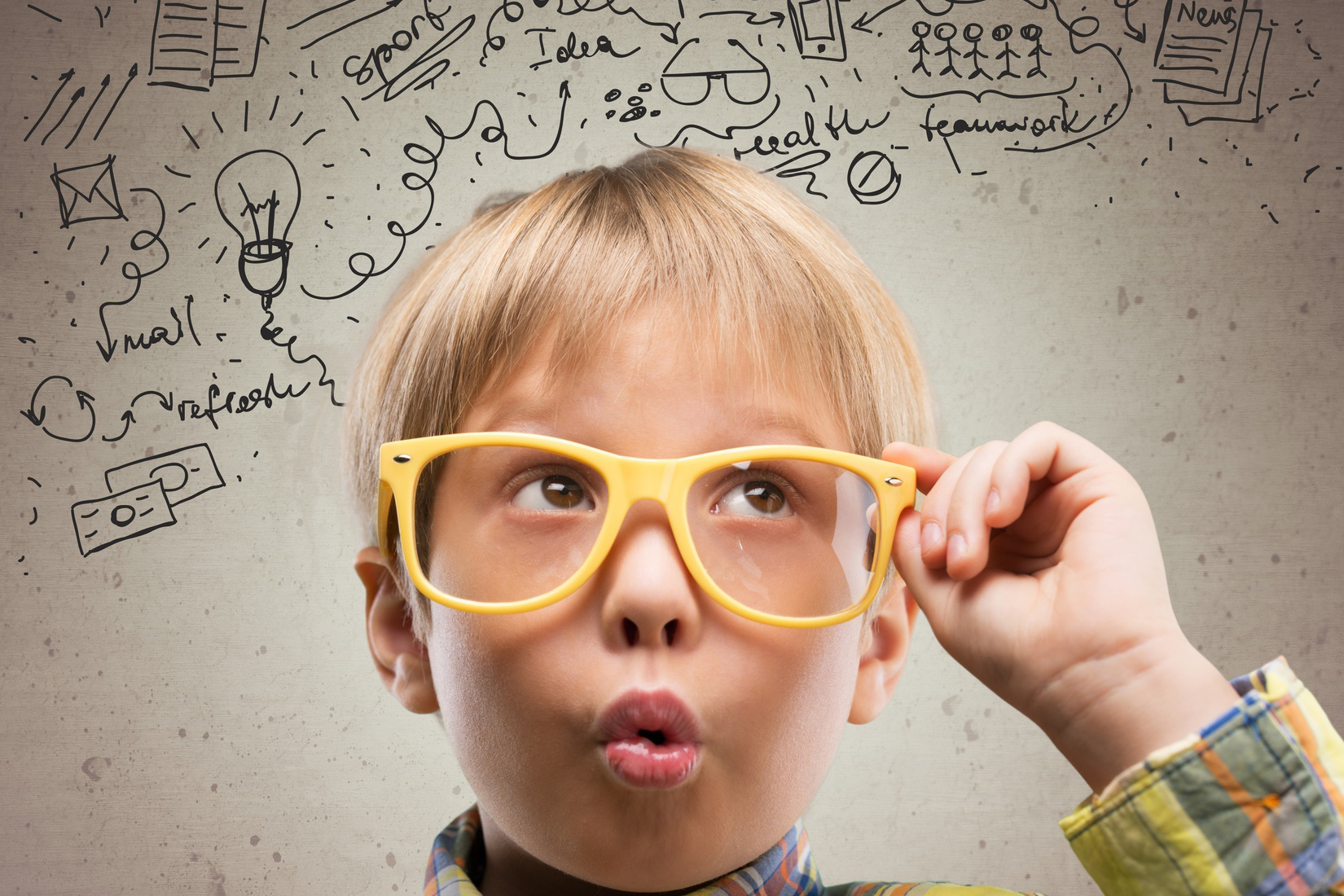 Kid. Thinking child with a blackboard in the background