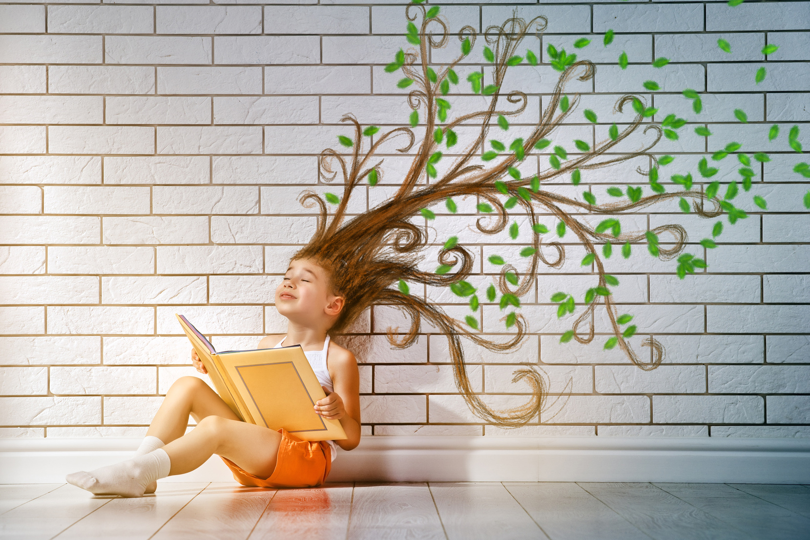 small beautiful child reading a book